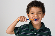 Small boy brushing his teeth